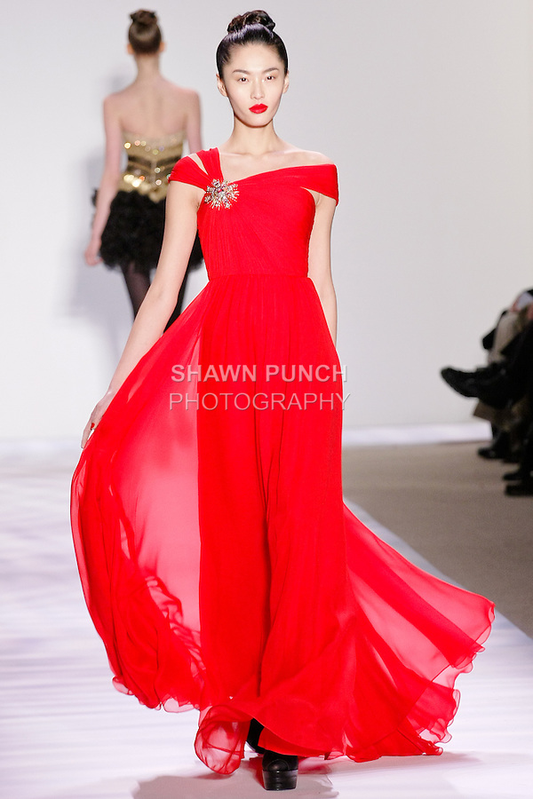Bonnie Chen walks the runway in a shanghai red chiffon gown with asymmetric neckline, by Monique Lhuillier for her Monique Lhuillier Fall 2010 collection, during the Mercedes-Benz Fashion Week Fall 2010.