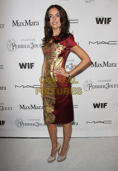 CAMILLA BELLE.3rd Annual Women In Film Pre-Oscar Party held At A Private Residence, Bel Air, California, USA..March 4th, 2010.full length red silk satin gold foil shiny print pattern patterned dress bracelet grey gray patent shoes wooden heel platform heels hand on hip.CAP/ADM/KB.©Kevan Brooks/AdMedia/Capital Pictures.