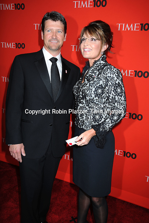 Todd Palin and Sarah Palin posing for photographers at the Time Celebrates the Time100 Issue Gala on May 4, 2010 at The Time Warner Center in New York City. The magazine celebrates the 100 Most Influential People in the World.