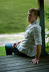 Young man seated on porch