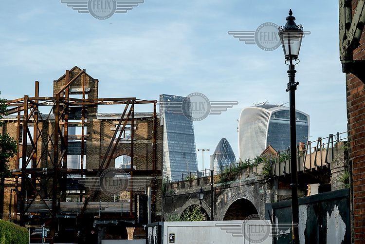 The City of London viewed from the behind Borough Market. <br /> <br /> L-R: The Leadenhall Building ('The Cheesegrate'), 30 St Mary Axe ('The Gherkin') &amp;  20 Fenchurch Street ('The Walkie-Talkie').