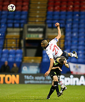 Bolton Wanderers' Darren Pratley jumps over Bury's Paul Caddis to win a header<br /> <br /> Photographer Alex Dodd/CameraSport<br /> <br /> The EFL Sky Bet League One - Bolton Wanderers v Bury - Tuesday 18th April 2017 - Macron Stadium - Bolton<br /> <br /> World Copyright &copy; 2017 CameraSport. All rights reserved. 43 Linden Ave. Countesthorpe. Leicester. England. LE8 5PG - Tel: +44 (0) 116 277 4147 - admin@camerasport.com - www.camerasport.com