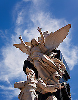 One of the many angel supltures in the Cementario del la Recoleta appears to be crowned with clouds.  The cemetary is located in the Recoleta Barrio of Buenos Aires, Argentina.