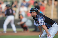 Kannapolis Intimidators manager Cole Armstrong (33) coaches third base during the game against the Delmarva Shorebirds at Kannapolis Intimidators Stadium on June 25, 2016 in Kannapolis, North Carolina.  The Intimidators defeated the Shorebirds 2-1.  (Brian Westerholt/Four Seam Images)