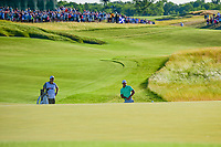 Brooks Koepka (USA) watches his chip on 18 during Sunday's round 4 of the 117th U.S. Open, at Erin Hills, Erin, Wisconsin. 6/18/2017.<br /> Picture: Golffile | Ken Murray<br /> <br /> <br /> All photo usage must carry mandatory copyright credit (&copy; Golffile | Ken Murray)