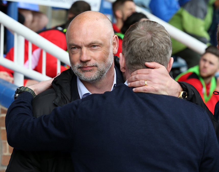 Fleetwood Town manager Uwe Rosler embraces Peterborough United manager Grant McCann before kick off<br /> <br /> Photographer David Shipman/CameraSport<br /> <br /> The EFL Sky Bet League One - Peterborough United v Fleetwood Town - Friday 14th April 2016 - ABAX Stadium  - Peterborough<br /> <br /> World Copyright &copy; 2017 CameraSport. All rights reserved. 43 Linden Ave. Countesthorpe. Leicester. England. LE8 5PG - Tel: +44 (0) 116 277 4147 - admin@camerasport.com - www.camerasport.com
