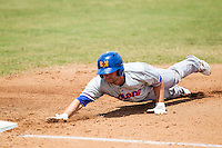 Midland RockHounds outfielder Matt Angle (29) dives back to first base during the Texas League baseball game against the San Antonio Missions on June 28, 2015 at Nelson Wolff Stadium in San Antonio, Texas. The Missions defeated the RockHounds 7-2. (Andrew Woolley/Four Seam Images)
