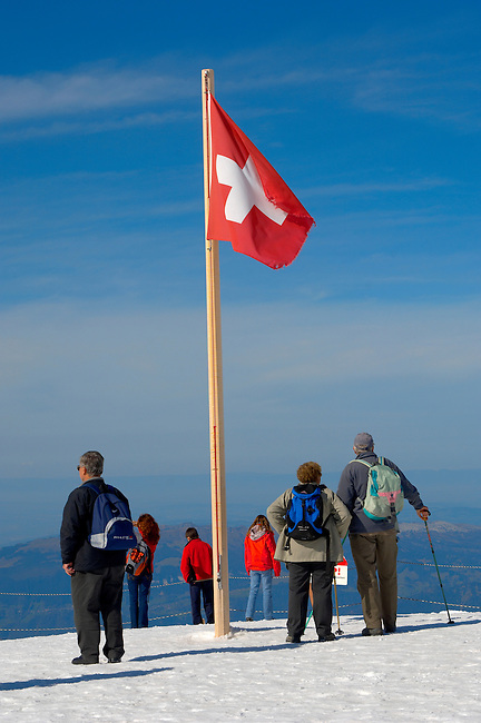 Jungfrau Top of Europe  and Swiss flag - Swiss Alps - Switzerland