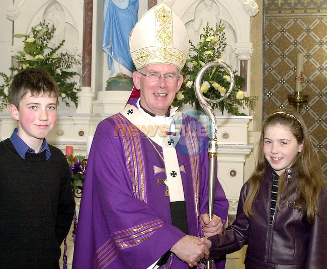 Most Rev. Dr. Sean Brady, Archbishop of Armagh with Oliver and Aoife Clare, Dunleer at the Re-Dedication of St. Brigid's Church, Dunleer...Picture Fran Caffrey Newsfile.