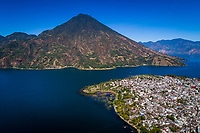Volcán San Pedro is seen opposite Santiago Atitlán on Lago de Atitlán, Guatemala in image taken with a drone on February 8, 2018. The town is the largest of many on the shores of the large lake, mostly comprised of Mayan descendants.