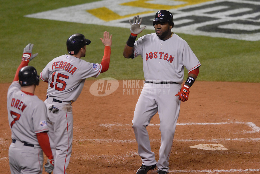 Oct 27, 2007; Denver, CO, USA; Boston Red Sox first baseman (34) David Ortiz is congratulated by second baseman (15) Dustin Pedroia and right fielder J.D. Drew after scoring in the third inning against the Colorado Rockies during game 3 of the 2007 World Series at Coors Field. Mandatory Credit: Mark J. Rebilas-US PRESSWIRE