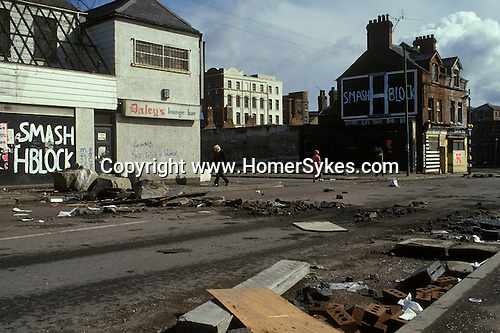 Ireland The Troubles. Belfast 1980s. The Falls Road after a night of rioting.