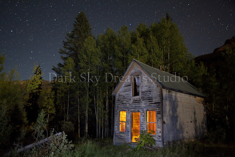 Starry skies over an abandoned house at the ghost town of Ironton, Colorado