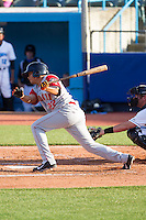 Dimas Ponce (22) of the Brooklyn Cyclones follows through on his swing against the Hudson Valley Renegades at Dutchess Stadium on June 18, 2014 in Wappingers Falls, New York.  The Cyclones defeated the Renegades 4-3 in 10 innings.  (Brian Westerholt/Four Seam Images)