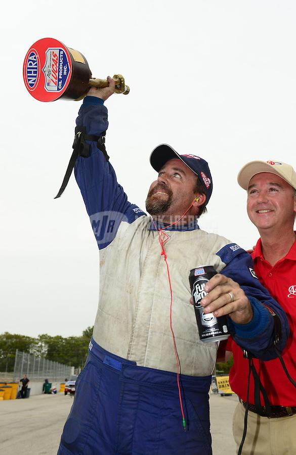 Sept. 30, 2012; Madison, IL, USA: NHRA competition eliminator driver Clint Neff celebrates after winning the Midwest Nationals at Gateway Motorsports Park. Mandatory Credit: Mark J. Rebilas-