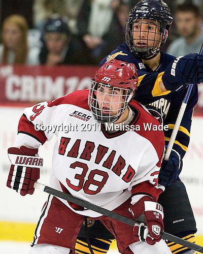 Loren Barron (Quinnipiac - 4), Conor Morrison (Harvard - 38) - The Harvard University Crimson and Quinnipiac University Bobcats played to a 2-2 tie on Saturday, November 5, 2011, at Bright Hockey Center in Cambridge, Massachusetts.
