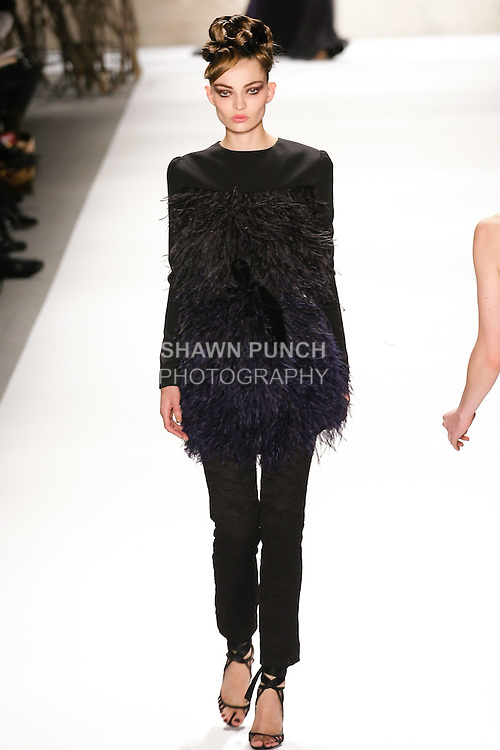 Carola walks runway in a Monique Lhuillier Fall 2011 outfit, during Mercedes-Benz Fashion Week Fall 2011.