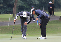 Alexander Bjorn (SWE) and Poor Saksansin (THA) on the 3rd green during Round 3 of the UBS Hong Kong Open, at Hong Kong golf club, Fanling, Hong Kong. 25/11/2017<br /> Picture: Golffile | Thos Caffrey<br /> <br /> <br /> All photo usage must carry mandatory copyright credit     (© Golffile | Thos Caffrey)