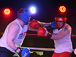 Gary O'Neill (Blue) who bear Keith Halpenny (Red) in the white collar boxing in Ardee parish centre. Photo:Colin Bell/pressphotos.ie