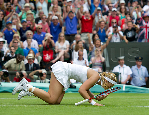 01.07.2013. Wimbledon,  London, England.  Day Seven of the The Wimbledon Tennis Championships 2013 held at The All England Lawn Tennis and Croquet Club, London, England, UK. Sabine Lisicki ( GER ) against Serena Williams ( USA ) Lisicki, the 23rd seed, won the fourth-round encounter 6-2 1-6 6-4 on Centre Court.