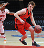 Michael Matich #23 of Floral Park, right, looks to get to the hoop during a non-league boys basketball game against Freeport at Nassau Coliseum in Uniondale on Tuesday, Dec. 4, 2018.