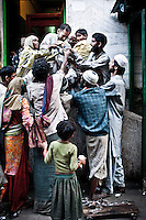 Kashmri poor muslims waiting for charity outside of a shrine in Srinagar. Muslims give charity to the poorest in the holy month of Ramadan. As the tradition is attended muslims has to fast from dawn to dusk, where they refrain from eating, drinking and smoking..