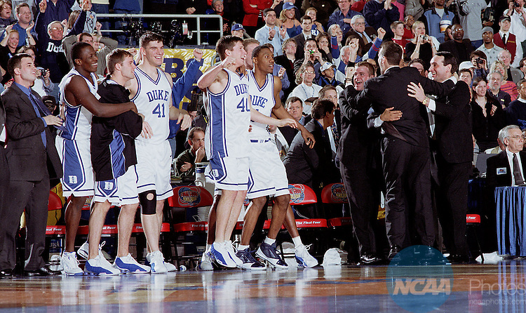 02 APR 2001:  Duke University bench and coaches start to celebrate in the closing seconds of the NCAA Men's National Basketball Final Four championship game held at the Hubert H. Humphery Metrodome in Minneapolis, MN. Duke defeated Arizona 82-72 for the title.  Rich Clarkson/NCAA Photos