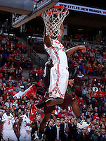 Ohio State Buckeyes forward Sam Thompson (12) and Louisiana-Monroe Warhawks guard Chinedu Amajoyi (13) get tangled up under the net during Friday's NCAA Division I basketball game at Value City Arena in Columbus on December 27, 2013. Ohio State won the game 71-31. (Barbara J. Perenic/The Columbus Dispatch)