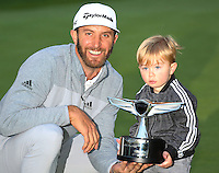 February 19, 2017: Dustin Johnson, winner of the 2017 Genesis Open poses with the trophy with his son Tatum at Riviera Country Club in Pacific Palisades, CA.