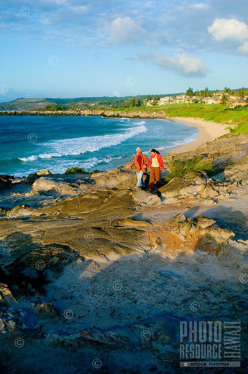 Romantic Couple Walk The Rugged Cliffs On Maui's North West Coast