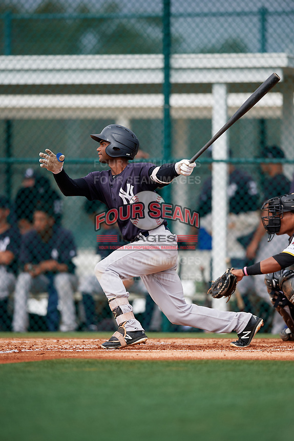 GCL Yankees East designated hitter Jose Villa (8) follows through on a swing during the first game of a doubleheader against the GCL Pirates on July 31, 2018 at Pirate City Complex in Bradenton, Florida.  GCL Yankees East defeated GCL Pirates 2-0.  (Mike Janes/Four Seam Images)