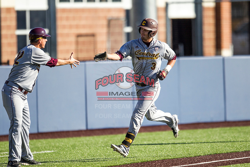 Central Michigan Chippewas third baseman Joe Houlihan (3) is greeted by head coach Steve Jaksa (22) after hitting a home run against the Michigan Wolverines on March 29, 2016 at Ray Fisher Stadium in Ann Arbor, Michigan. Michigan defeated Central Michigan 9-7. (Andrew Woolley/Four Seam Images)