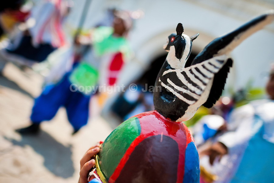 "Members of a dance group ""Los Historiantes"" perform the Dance of the Moors and Christians during the Flower & Palm Festival in Panchimalco, El Salvador, 8 May 2011. On the first Sunday of May, the small town of Panchimalco, lying close to San Salvador, celebrates its two patron saints with a spectacular festivity, known as ""Fiesta de las Flores y Palmas"". The origin of this event comes from pre-Columbian Maya culture and used to commemorate the start of the rainy season. Women strip the palm branches and skewer flower blooms on them to create large colorful decoration. In the afternoon procession, lead by a male dance group performing a religious dance-drama inspired by the Spanish Reconquest, large altars adorned with flowers are slowly carried by women, dressed in typical costumes, through the steep streets of the town."