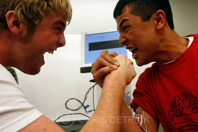 With electrodes attached to their arm muscles, Alta High School Juniors Nick Aluarez, right, and Justin Jeffries, 'Virtual Arm Wrestle' at the University of Utah Saturday, February 14, 2009. Using a technique called Electromyography, the electrodes were evaluating and recording the activation signal of muscles. An electromyograph detects the electrical potential generated by muscle cells when these cells contract, and also when the cells are at rest. .Meet An Inventor Dad had demonstrations of inventions, geared for teens and community college students to encourage them to enroll in university engineering courses...Chris Detrick/The Salt Lake Tribune..