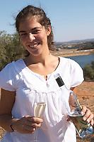 young woman tasting wine outside herdade do peso alentejo portugal