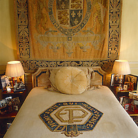"A tapestry depicting the arms of a Tudor Prince of Wales hangs above the Duke's bed as it did at Fort Belvedere, his house in England, and the bed cover is embroidered with the motto of the Order of the Garter, ""Honi Soit Qui Mal y Pense"""
