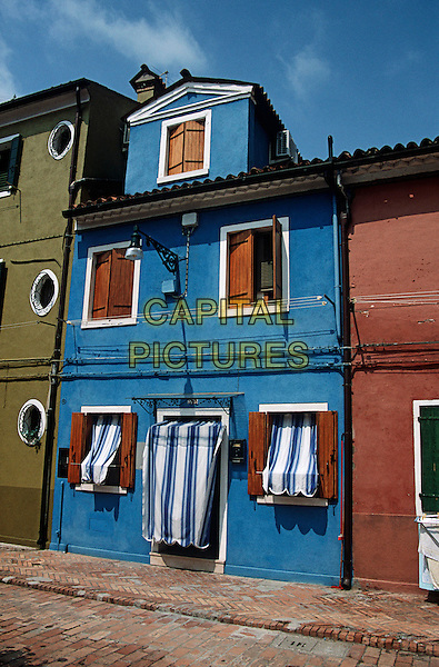 Blue painted house, typical of island of Burano, Burano, Venice, Italy