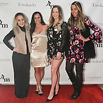 (l-r) Pilar Amukamara, Danielle Herzlich, Courtney Morrome, Courtney Wade attend the 3rd Annual Wives' Holiday Soiree at Totokaelo in SOHO on December 9, 2015.