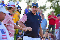 Phil Mickelson (USA) and Kevin Kisner (USA) fist bump on their way to 18th tee during round 2 Four-Ball of the 2017 President's Cup, Liberty National Golf Club, Jersey City, New Jersey, USA. 9/29/2017.<br /> Picture: Golffile | Ken Murray<br /> <br /> All photo usage must carry mandatory copyright credit (&copy; Golffile | Ken Murray)
