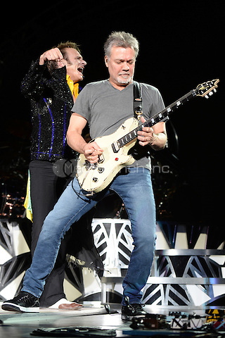 WEST PALM BEACH, FL - SEPTEMBER 15: David Lee Roth and Eddie Van Halen of Van Halen perform at The Perfect Vodka Amphitheater on September 15, 2015 in West Palm Beach Florida. Credit: mpi04/MediaPunch