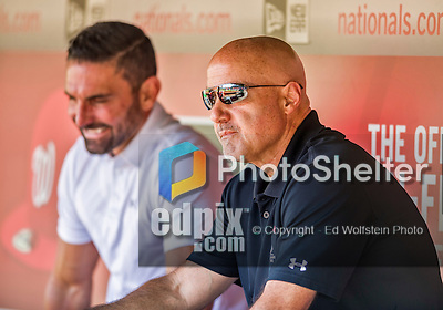 22 August 2015: Washington Nationals General Manager Mike Rizzo watches batting practice from the dugout with broadcaster F.P. Santagelo (left) prior to a game against the Milwaukee Brewers at Nationals Park in Washington, DC. The Nationals defeated the Brewers 6-1 in the second game of their 3-game weekend series. Mandatory Credit: Ed Wolfstein Photo *** RAW (NEF) Image File Available ***