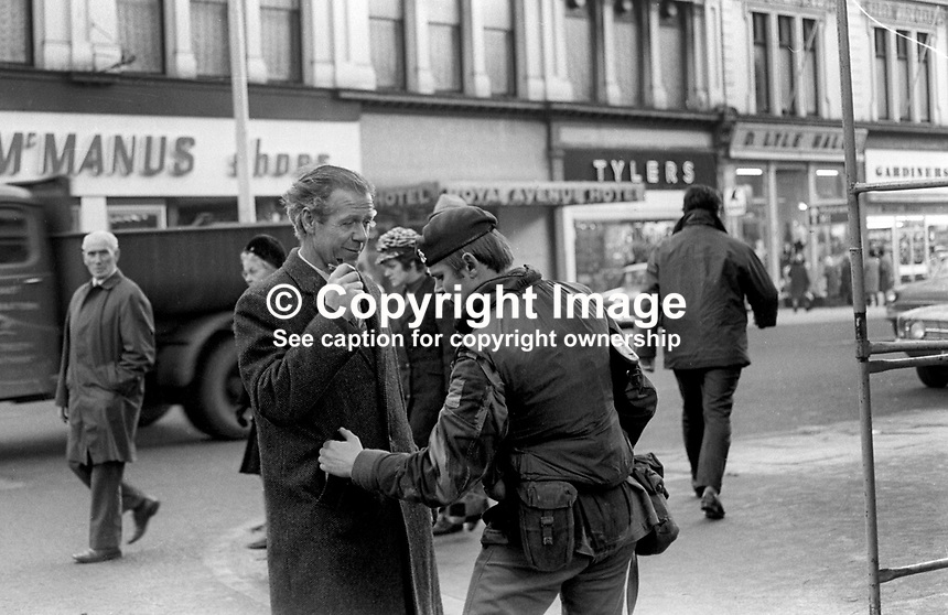 Soldiers on security duty in the run-up to Christmas 1972 routinely search shoppers, workers, etc, visiting the city centre in Belfast, N Ireland, December 1972. Generally it is endured with a mixture of stoicism and indifference, 197212070766c<br />