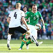June 11th 2017, Dublin, Republic Ireland; 2018 World Cup qualifier, Republic of Ireland versus Austria;  Glenn Whelan (c) of Ireland in action against Martin Hinteregger of Austria