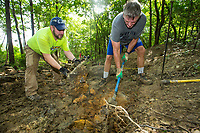 NWA Democrat-Gazette/BEN GOFF @NWABENGOFF<br /> David Godwin (left) of Springdale and Brooks Booher of Bentonville volunteer with Ozarks Off Road Cyclists to add rock armoring Saturday, July 6, 2019, at the intersection of Last Call and Terrapin Station at Kessler Mountain Regional Park in Fayetteville. Volunteers used 11 tons of stone to shore up the often muddy and erosion-damaged section of the trail and recently completed similar projects on other trails at the park. The Ozark Off Road Cyclists, the local chapter of the International Mountain Bicycling Association, are raising funds through their Kessler Campaign to fund further improvements and future trails at the park.