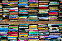 Spines of used books are seen stacked in shelves in a secondhand bookshop in San Salvador, El Salvador, 12 April 2018. Large collections of worn-out books, mostly textbooks and educational paperbacks, are sold regularly in secondhand bookshops in the center of the city.