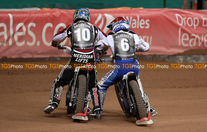 Heat 19: Hans Andersen (blue) and Nicki Pedersen (red) square up after the race - British Speedway Grand Prix at the Millennium Stadium, Cardiff - 10/07/10 - MANDATORY CREDIT: Rob Newell/TGSPHOTO - Self billing applies where appropriate - 0845 094 6026 - contact@tgsphoto.co.uk - NO UNPAID USE.