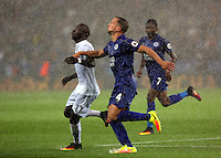 Pictured (L-R): Modou Barrow of Swansea City against Danny Drinkwater of Leicester City Saturday 27 August 2016<br />Re: Swansea City FC v Leicester City FC Premier League game at the King Power Stadium, Leicester, England, UK