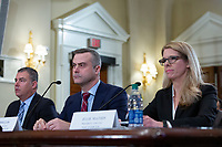 From left to right: Tom Burt, President and CEO of Election Systems & Software, John Poulos, President and CEO of Dominion Voting Systems, and Julie Mathis, President and CEO of Hart InterCivic, testify before the United States Committee on House Administration on Capitol Hill in Washington D.C., U.S., on Thursday, January 9, 2020.  Dominion Voting Systems, Hart InterCivic, and Election Systems and Software, the three main voting equipment producers in the United States, have faced criticism from lawmakers following Russian interference in the 2016 election.<br /> <br /> Credit: Stefani Reynolds / CNP/AdMedia