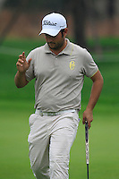 Alexnader Levy (FRA) putts on the 9th green during Thursday's Round 1 of the 2014 BMW Masters held at Lake Malaren, Shanghai, China 30th October 2014.<br /> Picture: Eoin Clarke www.golffile.ie