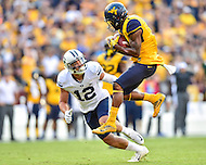 Landover, MD - SEPT 24, 2016: West Virginia Mountaineers wide receiver Shelton Gibson (1) catches a big third down pass over BYU Cougars defensive back Kai Nacua (12) during their match up at FedEx Field in Landover, MD. (Photo by Phil Peters/Media Images International)